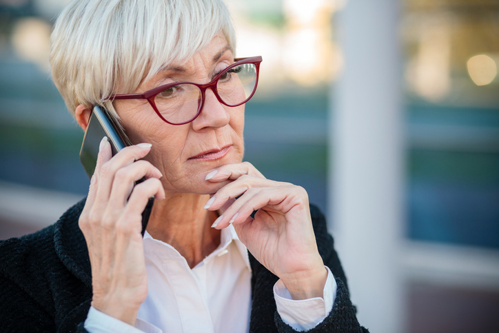older-business-woman-on-phone