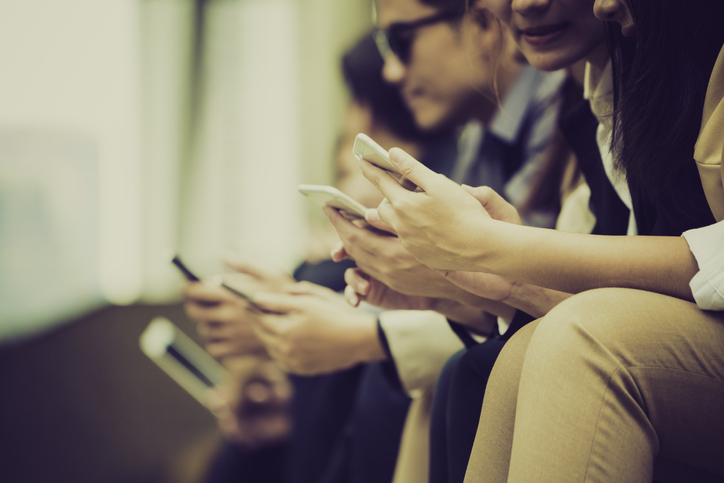 employees-on-word-cell-phones-sitting