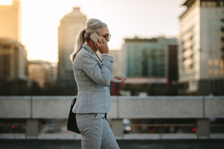 older-business-woman-on-cell-phone